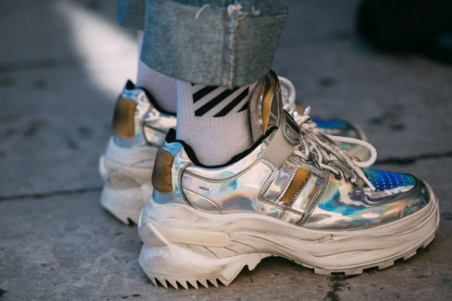 8277ffe4685c A guest paired trendy Off-White socks with shiny silver Maison Margiela  sneakers that featured a chunky platform sole and an iridescent finish.